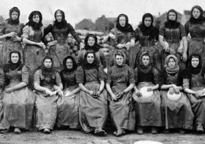 Historical black and white photo of herring women