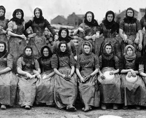 Historical black and white photo of herring women