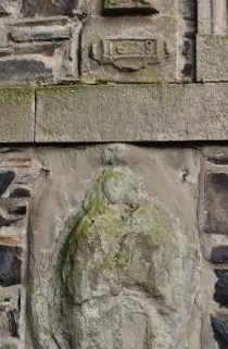 Carving of the Virgin Mary 1628 on Plainstones Banff