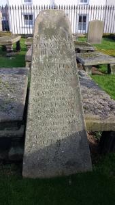 Colour photo of triangular-ish gravestone