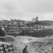 Black and white photograph of Macduff Harbour with Parish Church in the background