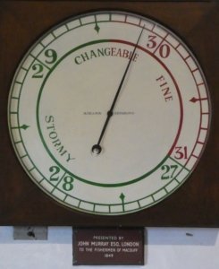 Photograph of large dial marine barometer donated to Macduff in 1949