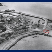 Grey scale aerial photo Macduff harbour area from circa 1930 with circled area to show the end of Rob Laing's pier.
