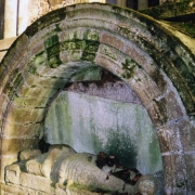 Provost Douglas's stolen tomb behind the Fife Mausoleum. The picture shows it when the slab with the Earl's inscription had slipped, showing the Douglas inscription behind.