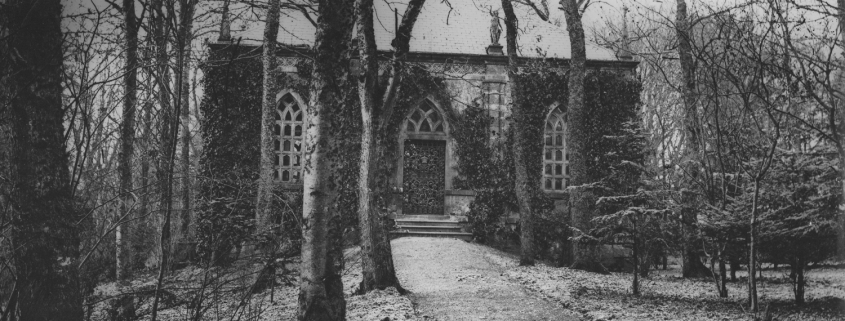 Black and white photo of the Mausoleum with trees and path in the foreground