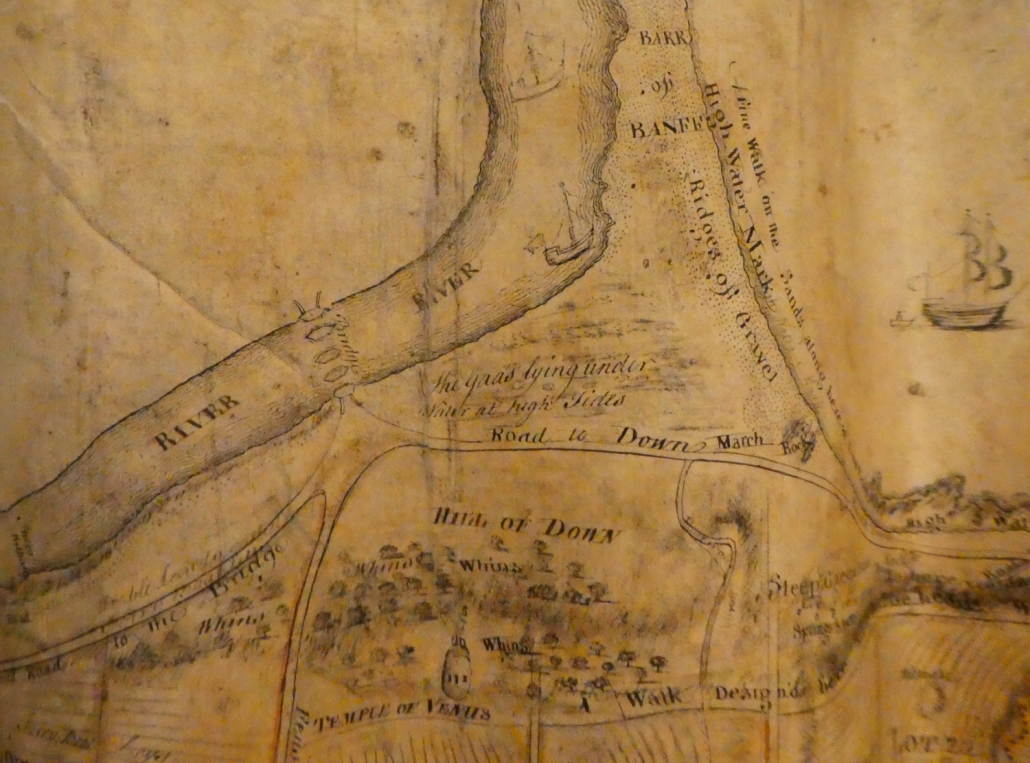 Photo of old yellowed map showing the River Deveron and the piers of the first Banff Bridge.